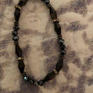 Black stretchy bracelet .